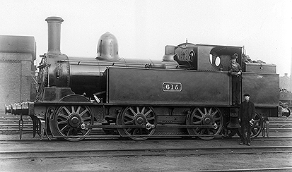 No.615 as originally built, with sloping smokebox door, wooden brake blocks operated only by the handbrake, and plain black livery. photo from the Mike Bentley collection